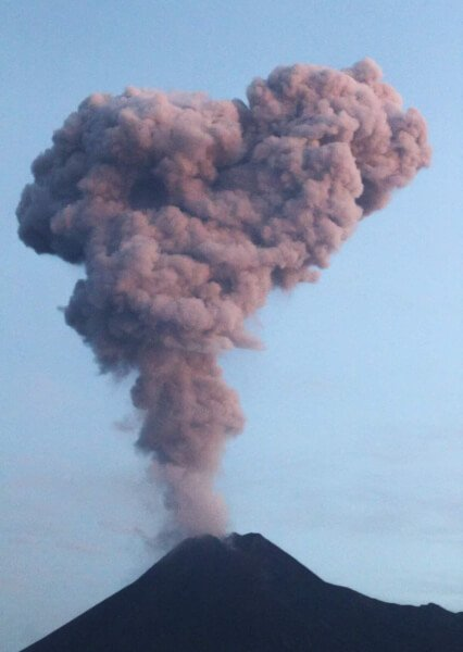 Indonesia Merapi volcano spits a large plume of smoke