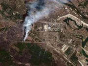 German aid for Chernobyl fires -  TEH