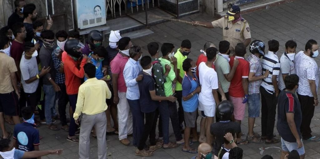 Crowd outside a liquor shop in India