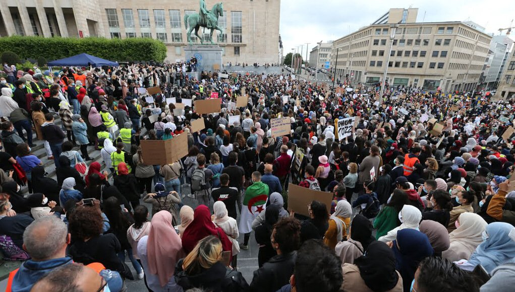 Protests in Brussels against the headscarf ban. headscarf ban, Belgium, europe, european union news, muslims islam news, muslim ladies, burqa, abaya, burka, head scarf ban. world news, breaking news, latest news; The Eastern Herald News
